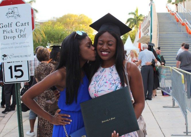 University Miami MBA Grad, University of Miami MBA Grad, black excellence, University of Miami, UM MBA grad, University of Miami MBA, Miami graduate, kiss on the cheek, friendship