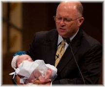 Pastor performing a baby dedication