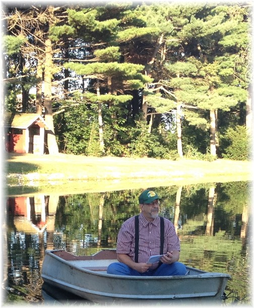 Preaching from boat at Galilean service 8/24/14 (Click for larger view)