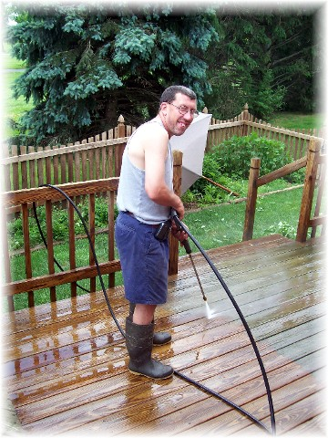 Ken powerwashing deck