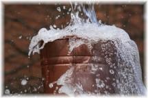 Overflowing water bucket