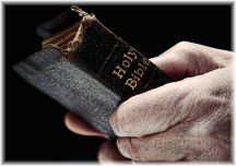 Old man holding Bible
