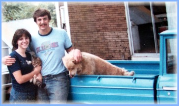 Stephen and Brooksyne with pets and Datsun pickup (1977)