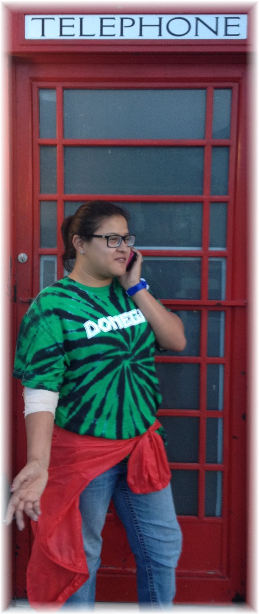 Ester at phone booth in Rehoboth Beach DE