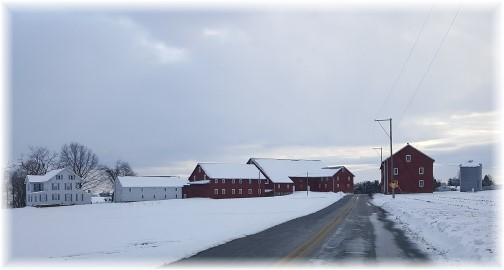 Red barns in snow along Harvest Road, in Lancaster County PA 2/10/16