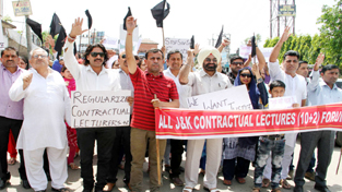 Representatives of different organizations participating in protest march by Contractual Lecturers on Sunday. 	-Excelsior/Rakesh