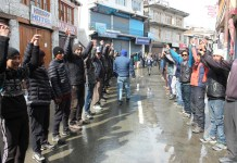 Protesters forming human chain at Kargil on Thursday.