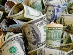 Dollar Higher on Safe Haven Interest