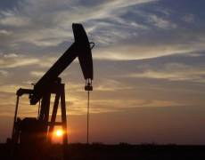 Oil Prices Slide Despite New Production Cuts