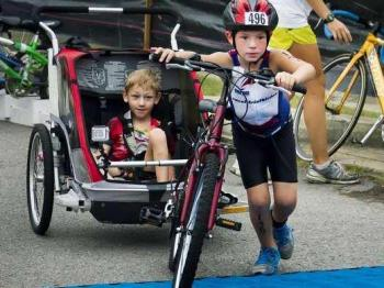 9-yr-old Helps Disabled Brother Finish Triathlons