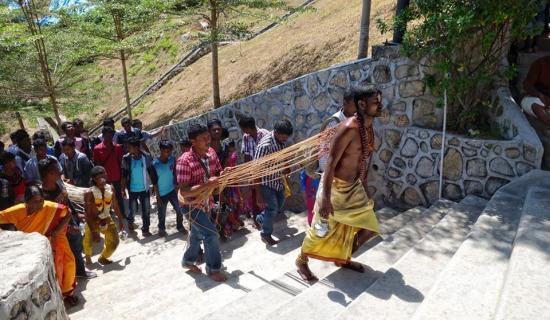 The pilgrim carries milk to offer to Murugan - copyright Fabian Graham