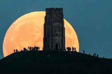 Moon rising over Glastonbury Tor