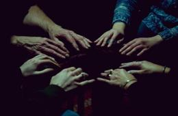 Seance hands. Photograph by Shannon Taggart.