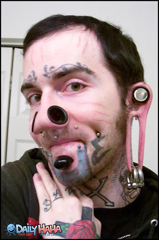 disgusting gross pierced face tattoo ugly