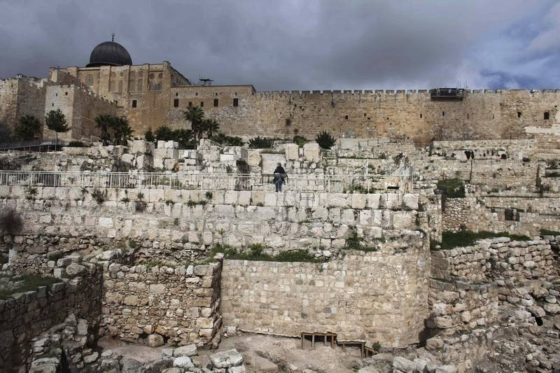 A journalist looks over newly excavated fortifications outside the Old City walls in Jerusalem on Monday.