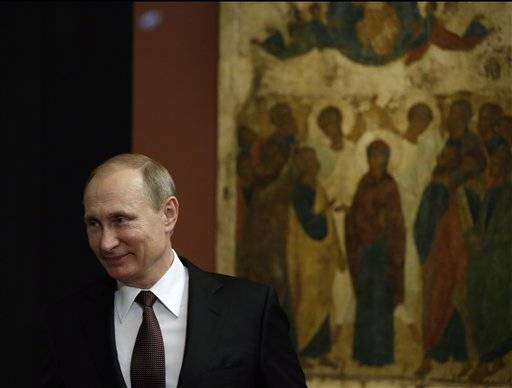 Putin blasts West on first trip to EU country this year