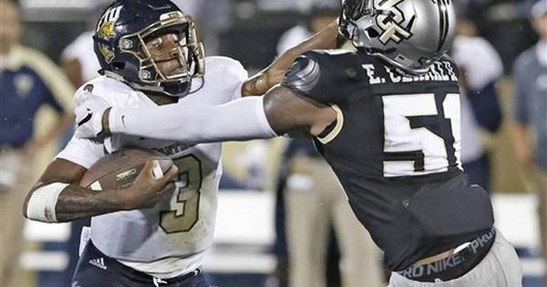 Wilson rushes for 3 TDS, UCF tops FIU 53-14
