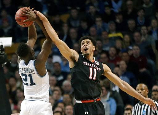 NCAA Latest: Kansas, Duke heads to OT in Elite 8 battle