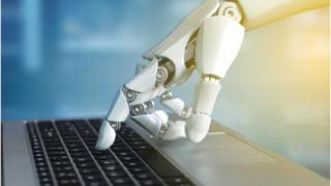 robot hand on a keyboard