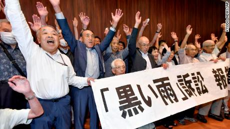 A group of claimants and supporters celebrating in Hiroshima after the court ruling on July 29, 2020.