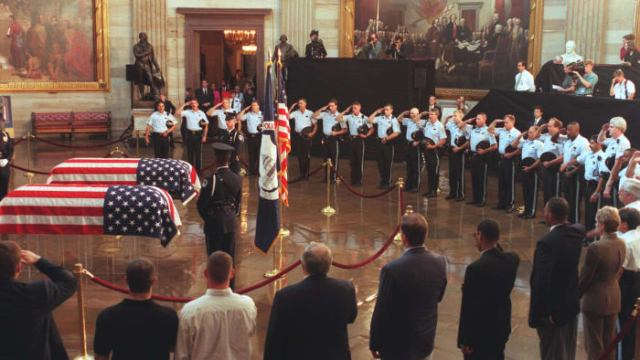Special Agent John Gibson and Officer Jacob Chestnut lying in the State