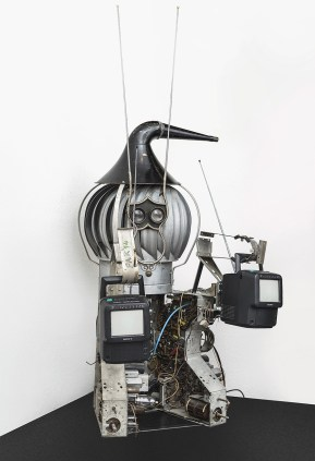 Nam June Paik, Game Byter, 1994, signed and dated on the left hook holding the tv, titled and dated on the laser disc Metal, Lasermax, three television sets 123 x 84cm , 47, 1/2 x 33 in