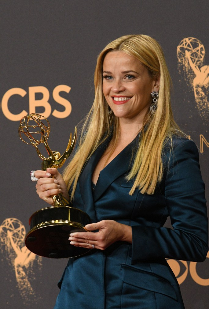 """Reese Witherspoon poses in the press room with the award for outstanding limited series for """"Big Little Lies""""J at the 69th Emmy Awards on Sunday, Sept. 17, 2017 at the Microsoft Theater in Los Angeles, California. (Photo by Michael Owen Baker / SCNG)"""