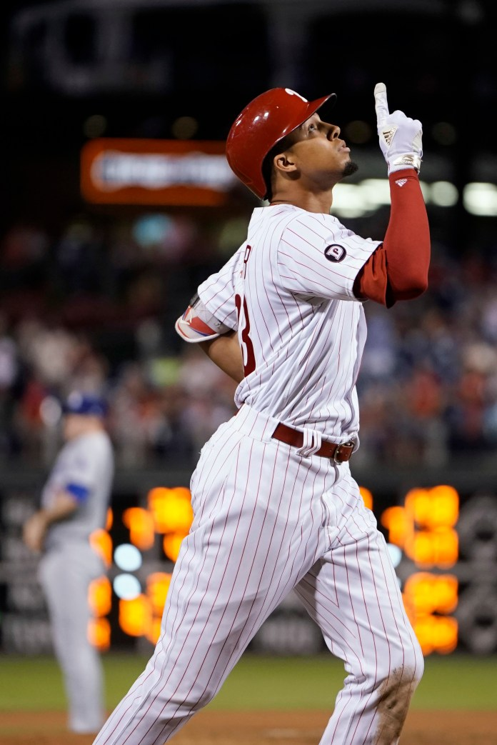 Philadelphia Phillies' Aaron Altherr, right, reacts as he rounds the bases after hitting a two-run home run off Los Angeles Dodgers relief pitcher Ross Stripling during the seventh inning of a baseball game, Wednesday, Sept. 20, 2017, in Philadelphia. Philadelphia won 7-5. (AP Photo/Matt Slocum)