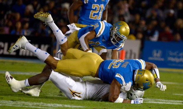 UCLA football keeps bowl hopes alive with win over Arizona ...