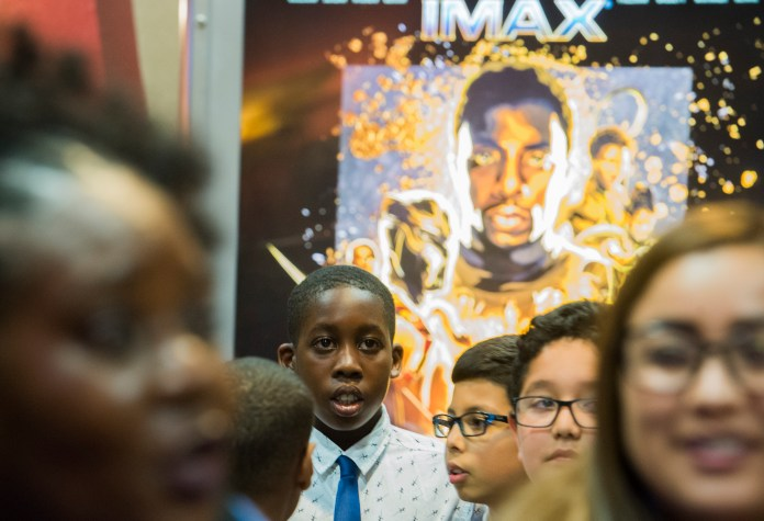 Chizzy Madu, 9, stands in line after watching the movie Black Panther as the Boys & Girls Club members got to watch the Black Panther movie at a special Boys & Girls Club IMAX screening in Long Beach Thursday, February 15, 2018. As part of the viral #BlackPantherChallenge campaign, IMAX, Regal Entertainment Group, Walt Disney Pictures and Marvel Studios, hosted an advance IMAX screening of Black Panther for the Boys & Girls Club Long Beach. Club members got to see the film before its nationwide release. (Photo by Thomas R. Cordova / Daily Breeze)