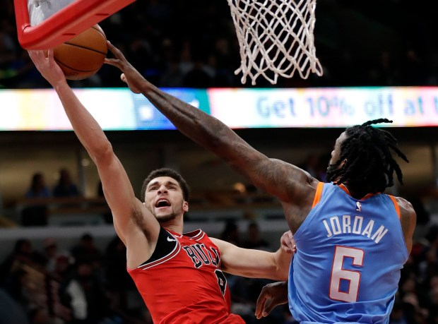 Chicago Bulls guard Zach LaVine, left, shoots against Los Angeles Clippers center DeAndre Jordan during the second half of an NBA basketball game, Tuesday, March 13, 2018, in Chicago. The Clippers won 112-106. (AP Photo/Nam Y. Huh)