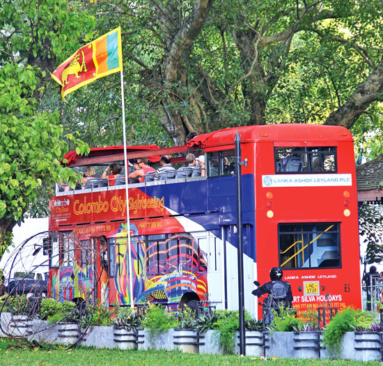 Tourists enjoying the Colombo City's sightseeing tour arranged by Ebert Silva Tours. Picture by Saliya Rupasinghe