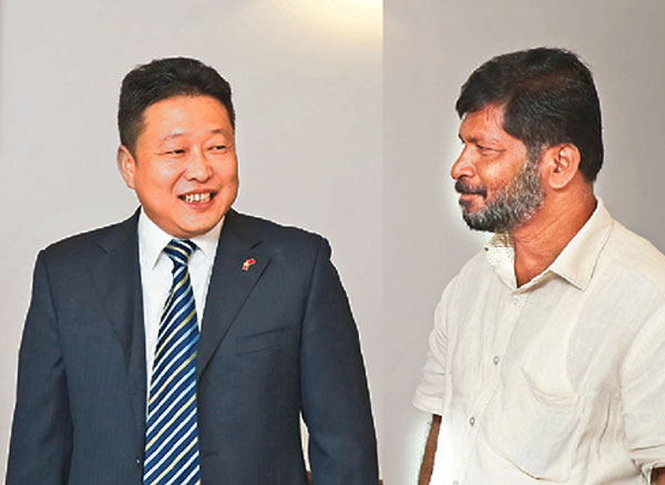 Sunil Silva with J. J. Le in Colombo