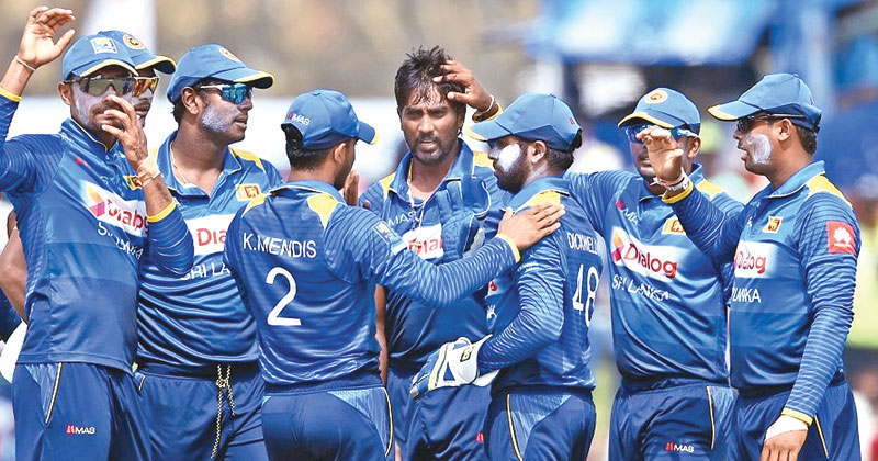 Sri Lanka's Nuwan Pradeep (C) celebrates with his teammates after he dismissed Zimbabwe's Solomon Mire during the second one-day internationals (ODI) cricket match between Sri Lanka and Zimbabwe at the Galle International Cricket Stadium in Galle on July 2. AFP