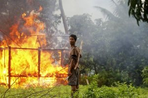 A Rohingya Muslim village burns in recent violence in Myanmar