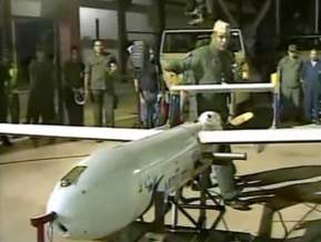 """A screengrab from a video released by the Venezuelan Ministry of Defense shows President Hugo Chavez inaugurating Iranian made """"Mohajer 2"""" drones"""