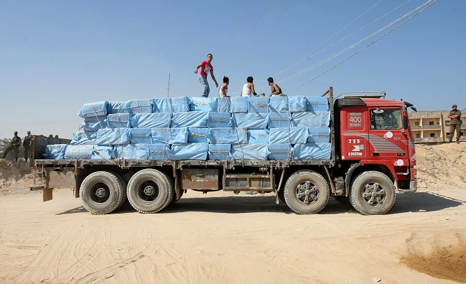 Economic restrictions put into place by the Israeli government encourage a thriving black market trade, a Palestinian truck carrying goods smuggled through tunnels leaves the Gaza-Egypt border in Rafah (File photo) AFP PHOTO/ SAID KHATIB