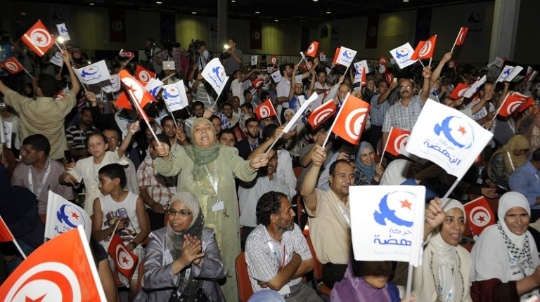 Ennahda party supporters cheer during a political rally (File photo) AFP PHOTO / FETHI BELAID