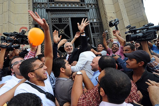 Abdel Moneim Abul Fotouh waves to supporters on the steps of the Supreme Court as he arrives to register the Strong Egypt party. (PHOTO BY MOHAMED OMAR)
