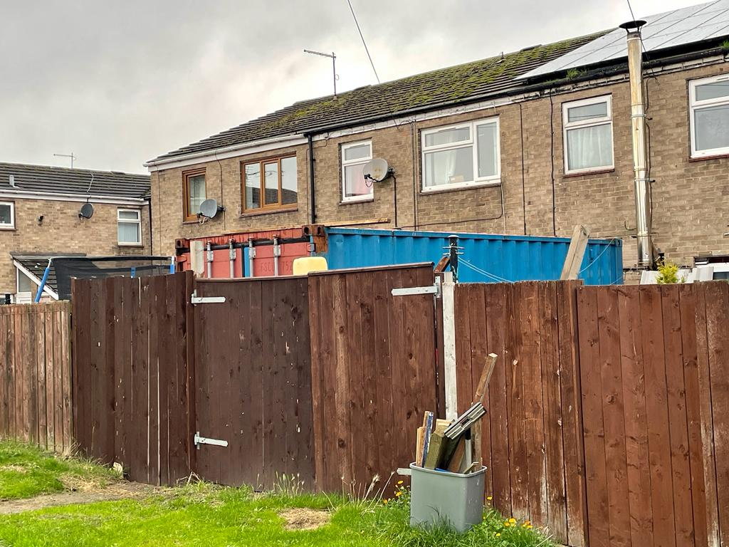 Furious mum left living next to 19ft 'eyesore' after neighbour dumped shipping container claiming it was a conservatory
