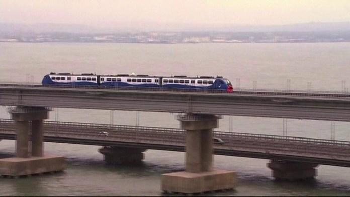 Putin's opens Crimea rail link, EU and Ukraine condemned