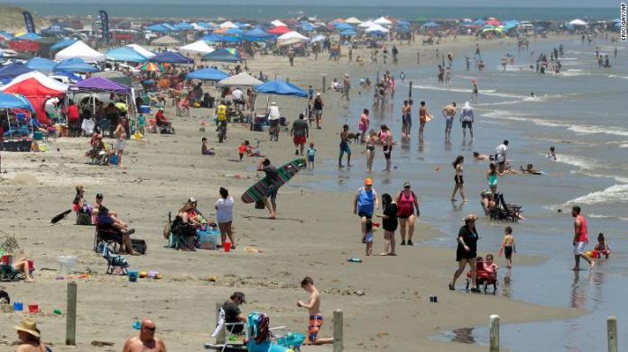Americans flock to beaches on Memorial Day weekend despite warnings