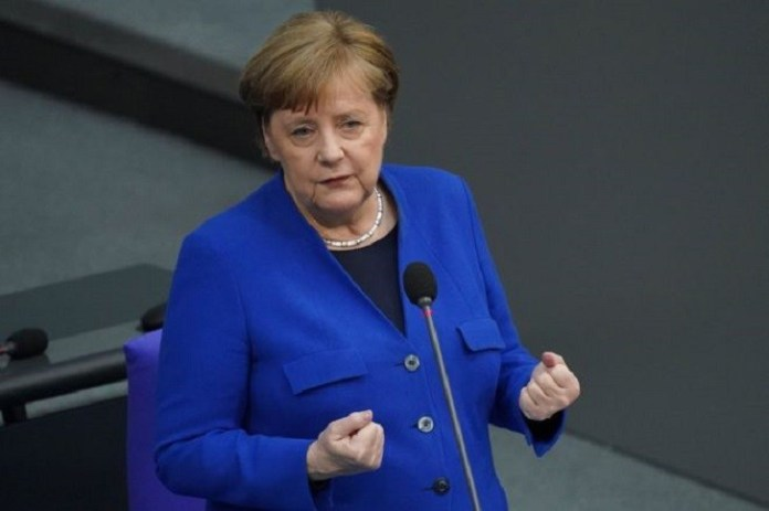 Germany's Merkel says she is 'pained' by Russian hacking
