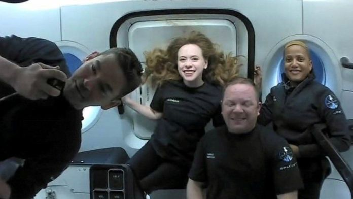 History-making space tourists splash down to earh