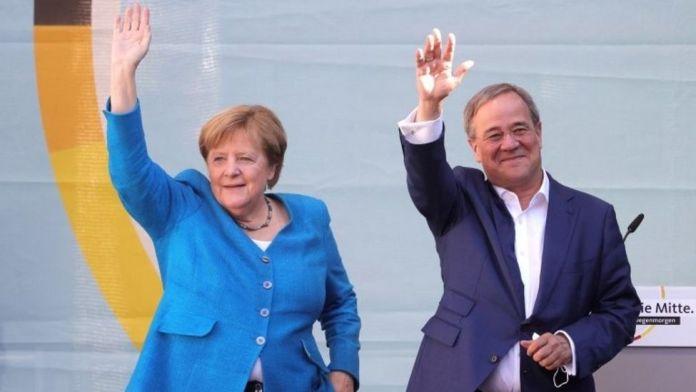 Merkel backs 'bridge-builder' Laschet as successor