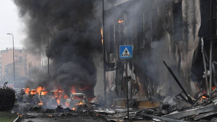 Eight dead as private jet hits building