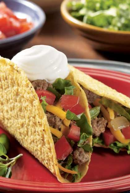 Spicy beef tacos with sour cream