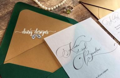 Simply Sophia invite on vellum with green envelope and gold liner
