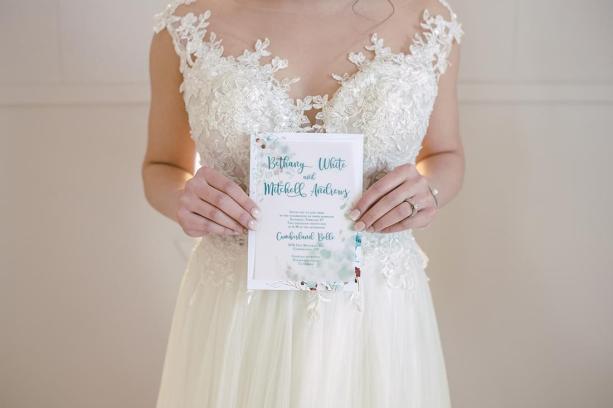 Cumberland Belle invite held by bride