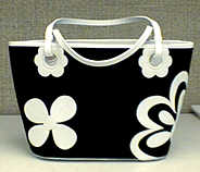 my month old new purse.  i got it at the clarks store.  it goes very well with the black and white flip-flops i got in vacaville while i was shopping with my dad and his wife.  you know you love it.